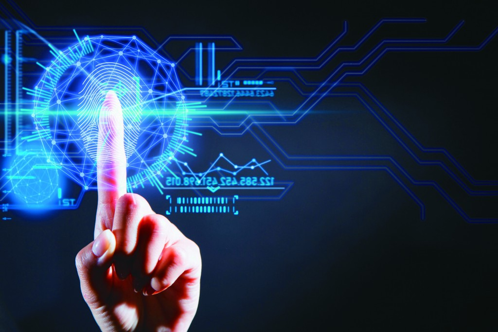 Woman's index finger touching a security user interface technology and scanning her fingerprint.